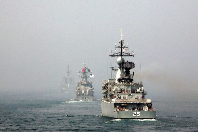 "Naval frigates, (from R to L) Malaysia's KD Kasturi, Bangladesh's BNS Abu Bakar and Singapore's RSS Formidable, participate in multi-country maritime joint exercises off the coast in Qingdao, Shandong province April 23, 2014. The Chinese People's Liberation Army (PLA) Navy organized its first multilateral maritime exercises, dubbed ""Maritime Cooperation - 2014"", off the coast of the eastern Chinese city Qingdao on Wednesday, where 19 ships, seven helicopters and marine corps from eight countries including C"