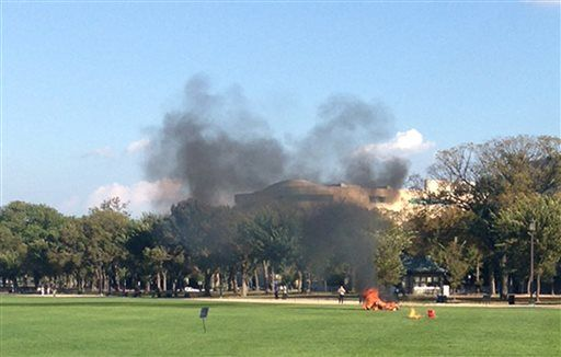 A man lit himself on fire in the National Mall.  Joggers seen running to put out the fire.  Obama is nowhere to be seen.