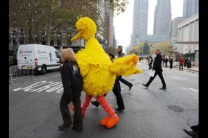 Security cautiously escorts Big Bird actor off the set shortly after recording the groundbreaking episode.