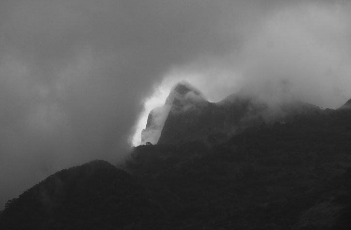 Black and White Photo of mountain with clouds