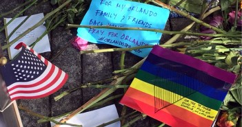 Flowers, notes and flags remain after the vigil in the courtyard of the 9/11 museum for the Orlando shooting.