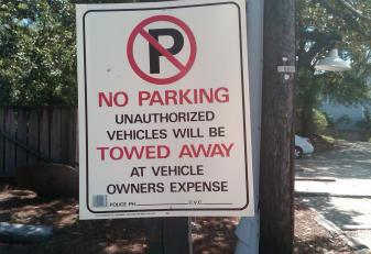 No parking tow sign