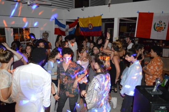 """Students dance to Caribbean rhythms at the Four Winds. """"We get it...Latinx people love 'Suavemente',"""" first-year Sofia Jimenez said."""