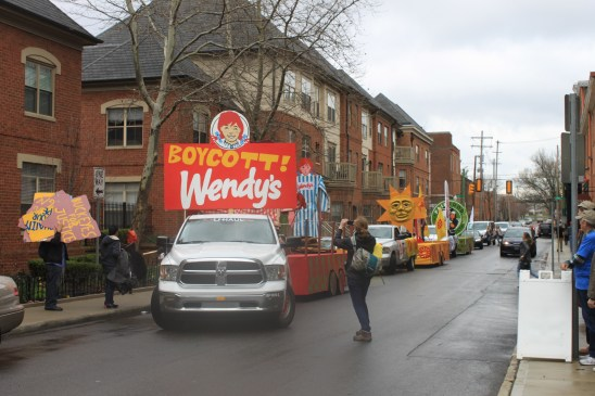 The floats lined up on a side street, waiting for the parade