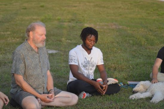 Stephen Gillum (on the left) leading meditation at the Bayfront on Apr. 12th after the one day fast some students participated in for the Boycott Wendy's campaign. Photo by Kelly Wilson
