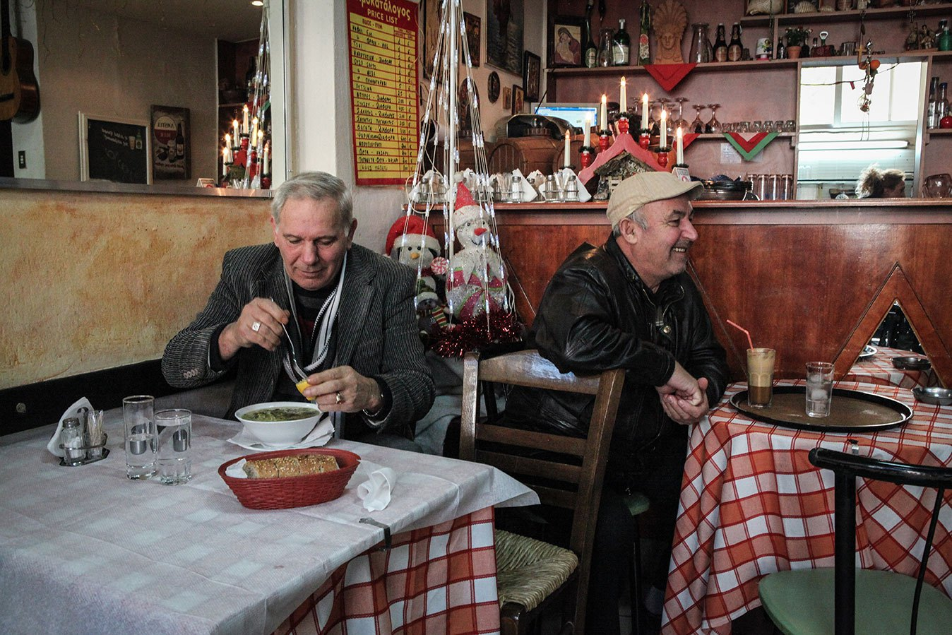 In the poor neighborhood of Xirokrini, a small restaurant operated by an Albanian lady is never empty. She offers a combination of a main dish or soup and a drink for the reasonable price of 3 euro.