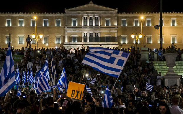 Greeks rally in front of the Hellenic Parliament.