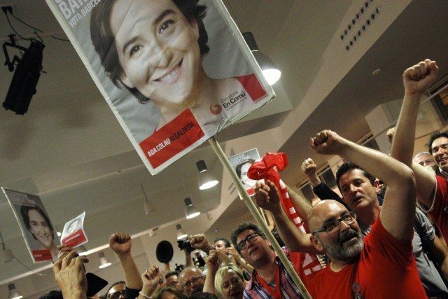 Ada Colau supporters from Barcelona en Comu holding signs and celebrating her victory