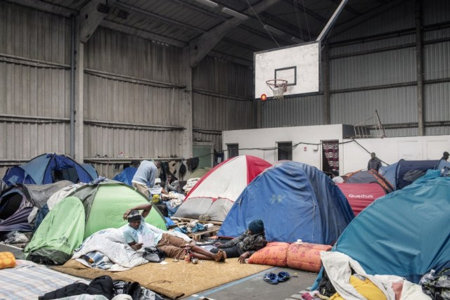 Migrants at makeshift tent camp in France