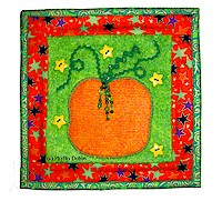 Free pattern: Pumpkin mini quilt