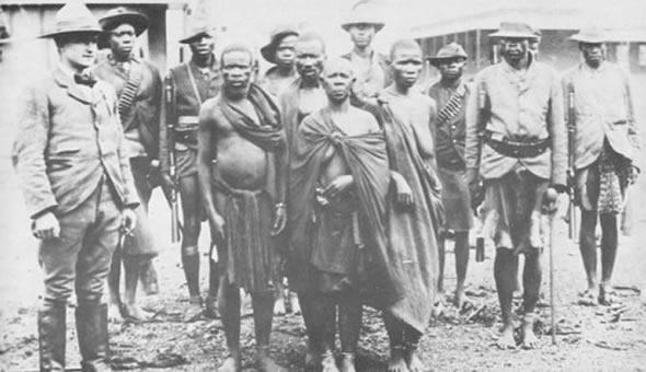 Mbuya Nehanda (centre) with Sekuru Kaguvi (left)