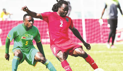 COMEBACK KID . . . .Zimbabwe wingback, Hardlife Zvirekwi (left), seen here shadowing Malawi's Fischer Kondowe in the quarter-finals, returns to the Warriors' starting XI today for the Cosafa Cup final against Zambia