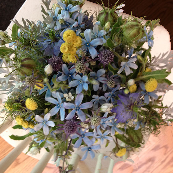 Bridal bouquet of early summer wildflowers .