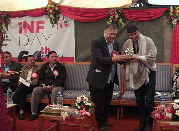Mr. Ramchandra Timothy, Chairman, INF Nepal distributing token of love to Karna Das.