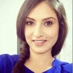 nisha-adhikari-with-hair.jpg