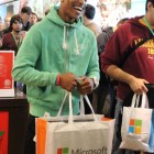 An attendee happy to have his Xbox One in hand.