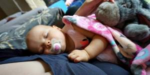 why should you hold your baby when they are napping feature
