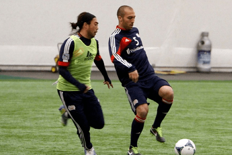 Lee Nguyen and A.J. Soares battle for the ball in a preseason scrimmage earlier this winter. (Photo: Chris Aduama/aduama.com)
