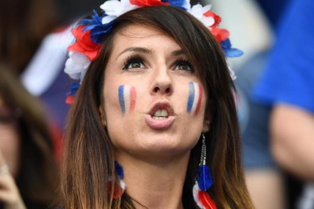 A France supporter cheers prior to the Euro 2016 group A football match between France and Romania at Stade de France, in Saint-Denis, north of Paris, on June 10, 2016. / AFP PHOTO / FRANCK FIFE