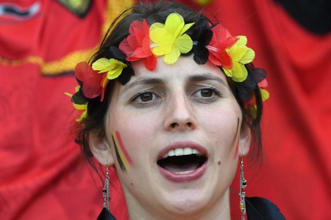 A Belgium supporter cheers prior to the Euro 2016 round of 16 football match between Hungary and Belgium at the Stadium Municipal in Toulouse on June 26, 2016. / AFP PHOTO / PASCAL GUYOT