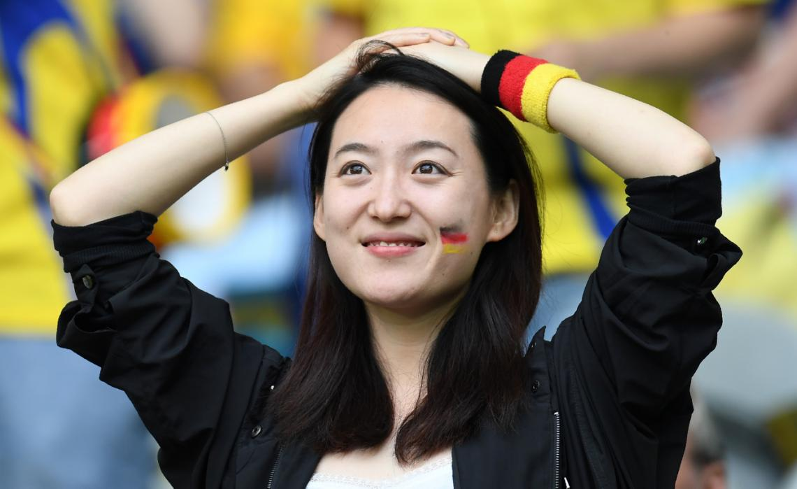A German supporter is pictured ahead of the Euro 2016 group C football match between Germany and Ukraine at the Stade Pierre Mauroy in Villeneuve-d'Ascq near Lille on June 12, 2016. / AFP PHOTO / PATRIK STOLLARZ