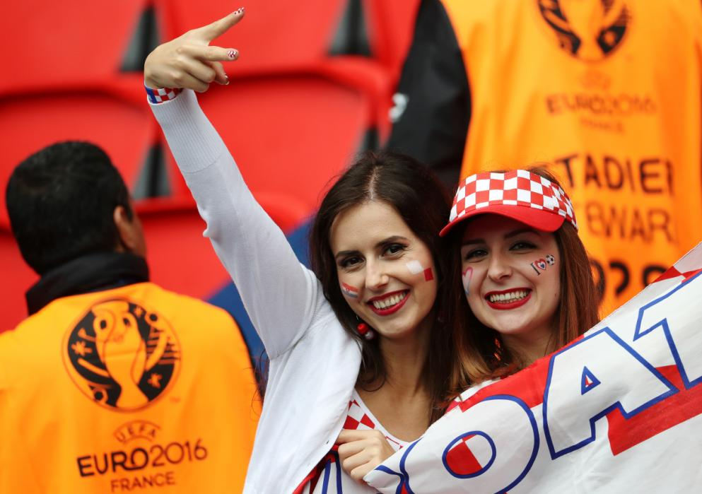 Croatia supporters smile prior to the start of the Euro 2016 group D football match between Turkey and Croatia at Parc des Princes in Paris on June 12, 2016. / AFP PHOTO / KENZO TRIBOUILLARD