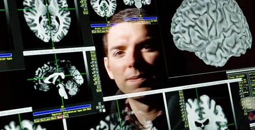 This image is of Aron Barbey and his brain scans.