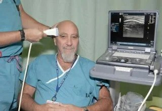 The image shows the researcher using the TUS