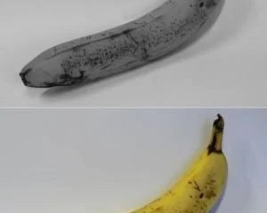 The image shows a banana in color and one in black and white.