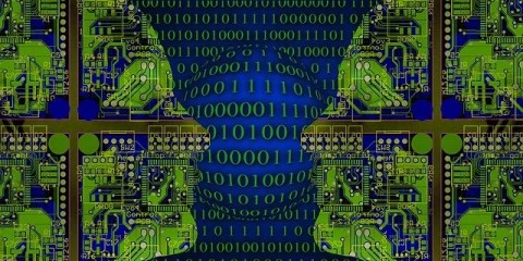 This image shows binary computer code in blue and the outline of two heads.