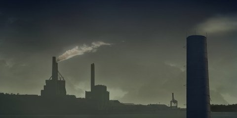 This image shows industrial smoke stacks pumping out smoke into the air.