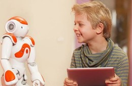 Photo of a small boy with the robot.