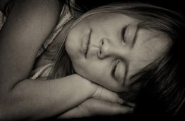 Image shows a girl sleeping.