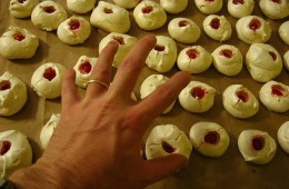 Image shows a person reaching for cookies.