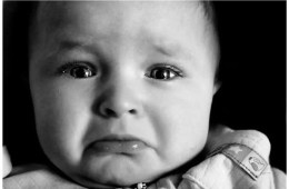 Image shows a crying baby.