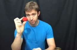 Image shows the researcher holding a red ball.