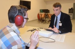 Image shows someone undertking a hearing test.