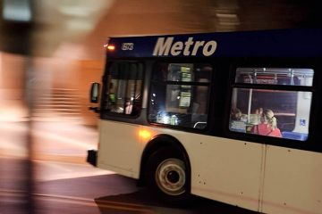 Image shows a moving bus.