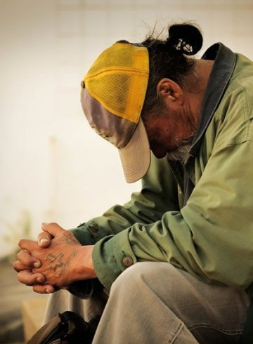 Image shows a homeless man.