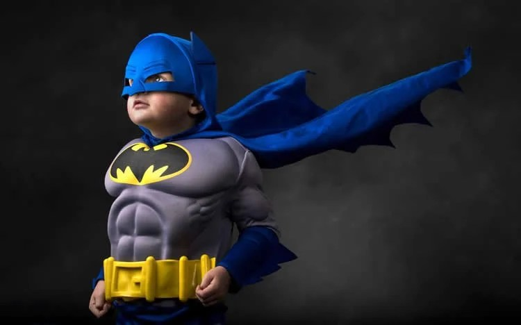 Image shows a boy in a Batman costume.