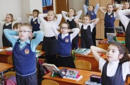 Image shows school kids exercising.