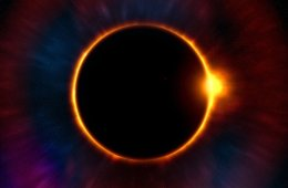 Image shows thge sun being eclipsed by the moon.