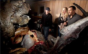 Halloween Horror Nights creative director John Murdy (left) guides a pair of guests past the queasy horrors of The Thing: Assimilation.