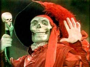 In the film's two-tone Technicolor sequence, the Phantom disguises himself as the Red Death