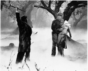 Talbot's father (Claude Rains) defends Gwen (Evelyn Ankers) from the Wolf Man (Lon Chaney)