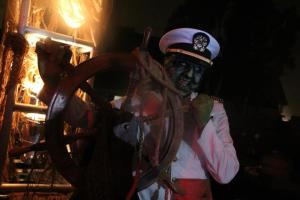 Queen Mary Dark Harbor 2012 The Captain at the tiller