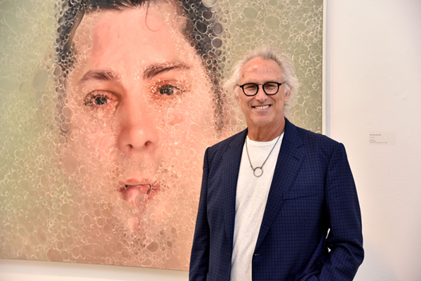 """Eric Fischl at the opening reception for """"Water Bodies"""" at Southampton Arts Center. Courtesy of photographer Jared Siskin, © Patrick McMullan."""