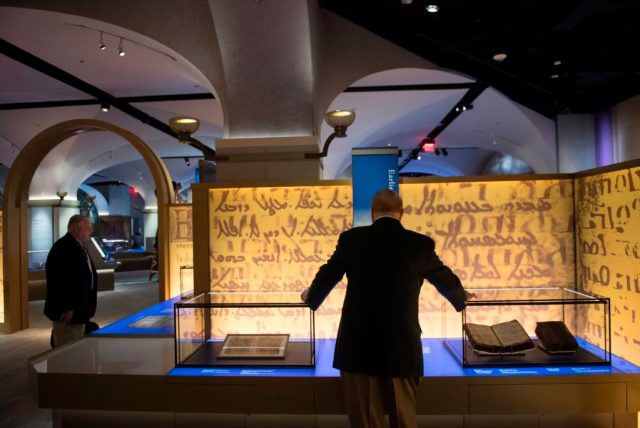 """Visitors tour the """"History of the Bible"""" exhibit at the Museum of the Bible n Washington, DC. Photo by Saul Loeb, courtesy of AFP Photo/Getty Images."""