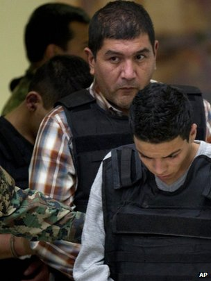 Ivan Velazquez Caballero is paraded before the cameras. 27 Sept 2012