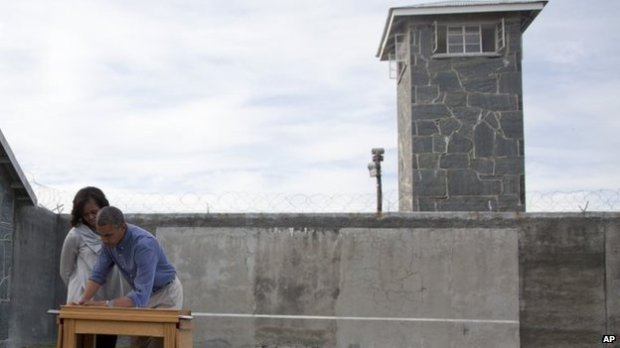 President Obama signs the visitors' book on Robben Island, 20 June 2013